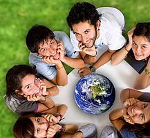 Young people sitting around a model of the planet. Picture: Andres Rodriguez/Fotolia.com